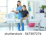 physiotherapist working with... | Shutterstock . vector #567307276