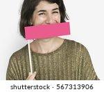 caucasian woman holding flag... | Shutterstock . vector #567313906