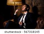 Handsome Man Drinking Whiskey...