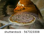 making pizza in a bread wood... | Shutterstock . vector #567323308