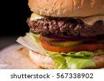 hamburger close up on black... | Shutterstock . vector #567338902