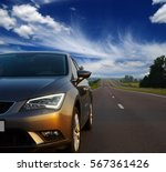 silver car and on the road | Shutterstock . vector #567361426