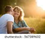 son kissing her affectionate... | Shutterstock . vector #567389632