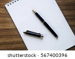 opened notepad with pen  small... | Shutterstock . vector #567400396