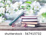 books and eyeglasses outdoors... | Shutterstock . vector #567415732