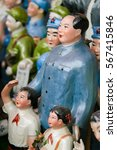 Small photo of BEIJING, CHINA - SEPTEMBER 17, 2007: Statues of Mao and other communist memorabilia on an antique market in Beijing, China