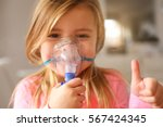 little girl using inhaler and... | Shutterstock . vector #567424345