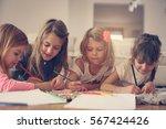 four girls lying on the floor... | Shutterstock . vector #567424426