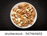 bowl with nuts in center on... | Shutterstock . vector #567464602