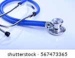 red heart and a stethoscope on... | Shutterstock . vector #567473365