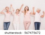 group of happy women winning... | Shutterstock . vector #567475672