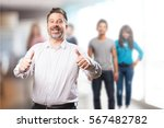 middle aged man doing ok | Shutterstock . vector #567482782