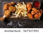 fried chicken legs with french... | Shutterstock . vector #567527392