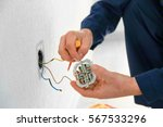electrician attaching wires to... | Shutterstock . vector #567533296