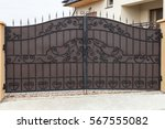 new forged metal double gates... | Shutterstock . vector #567555082