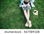 top view of woman sitting in... | Shutterstock . vector #567589108