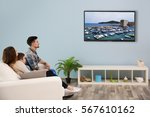 family watching television at... | Shutterstock . vector #567610162
