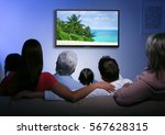 family watching television at... | Shutterstock . vector #567628315