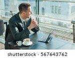young businessman in suit... | Shutterstock . vector #567643762