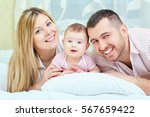 beautiful mother  father and... | Shutterstock . vector #567659422