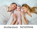 mother and father happy smiling ... | Shutterstock . vector #567659446