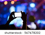 hand with a smartphone records... | Shutterstock . vector #567678202