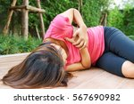 Small photo of Sporty woman having heart attack at park- Angina Pectoris, Myocardial Infarction