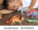 little boy playing with toys... | Shutterstock . vector #567696922
