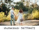 the bride and groom in nature.... | Shutterstock . vector #567706672