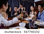 adults having dinner at home | Shutterstock . vector #567740152