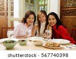 three women sitting at... | Shutterstock . vector #567740398
