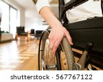 young disabled woman in... | Shutterstock . vector #567767122