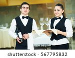 young waiter and waitress at... | Shutterstock . vector #567795832