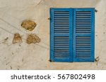 blue wooden window shutters of... | Shutterstock . vector #567802498