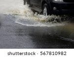 motion car rain big puddle of... | Shutterstock . vector #567810982