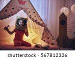 child in an astronaut costume... | Shutterstock . vector #567812326