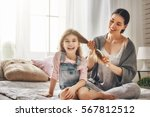 happy loving family. mother is... | Shutterstock . vector #567812512
