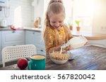 cute little girl eating cereal...   Shutterstock . vector #567820042