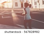 woman running in the evening on ... | Shutterstock . vector #567828982