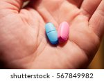 two pills in arm blue and pink. ... | Shutterstock . vector #567849982