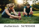happy young man and woman... | Shutterstock . vector #567850408