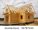Unfinished, ecological wooden house and building area - stock photo