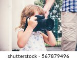 Little Girl Holding A Camera...