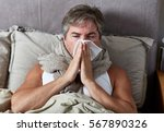 sick man in bed | Shutterstock . vector #567890326