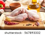 raw chicken legs with spices on ... | Shutterstock . vector #567893332
