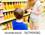 child and his mother choosing... | Shutterstock . vector #567909382