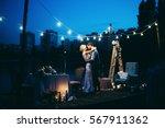 amazing wedding couple near the ... | Shutterstock . vector #567911362
