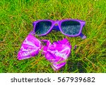 sunglasses and bow tie on the... | Shutterstock . vector #567939682