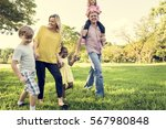 family walking field nature... | Shutterstock . vector #567980848