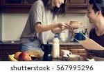 couple eating morning breakfast ...   Shutterstock . vector #567995296